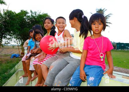 Group of children with a balloon, Margaritha children's home, Marihat, Batak region, Sumatra island, Indonesia, - Stock Photo
