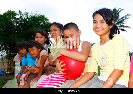 Group of children with a balloon, Margaritha children's home, Marihat, Batak region, Sumatra island, Indonesia, - Stock Photo