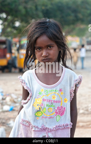 Unhappy young poor lower caste Indian street girl. Andhra Pradesh, India - Stock Photo