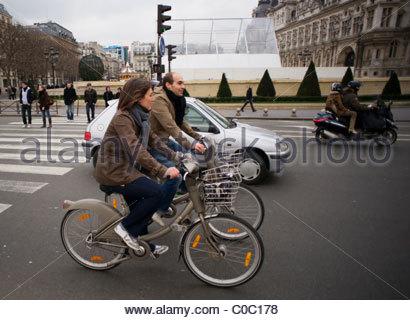 People riding bikes bicycles Paris France - Stock Photo
