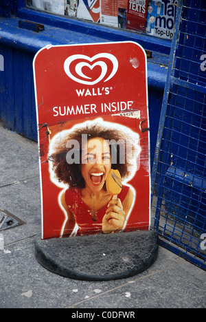 A rather battered Walls ice cream sign outside a shop in Edinburgh's Grassmarket. - Stock Photo