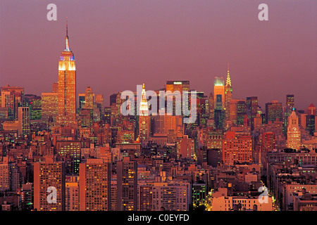 New York City skyline looking North from lower Manhattan with The Empire State Building and Chrysler Building at - Stock Photo