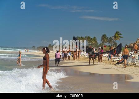 Kite surfer and teenager at Playa del Este, Santa Maria Del Mar, near Havanna Cuba - Stock Photo