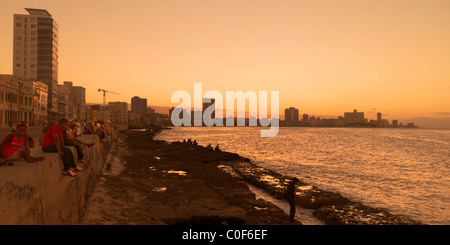 Malecon Promenade at sunset, Havanna Vieja, Cuba - Stock Photo
