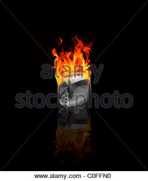 Ice cube on fire - Stock Photo