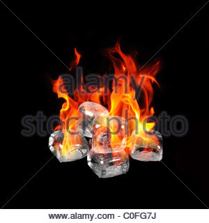 Ice cubes on fire - Stock Photo