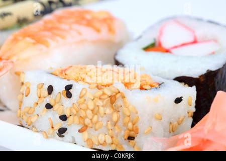 Mixed sushi on a plate with pickled ginger - Stock Photo
