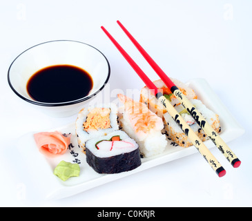 Mixed sushi on a plate with shallow depth of focus - Stock Photo