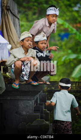 Balinese children gather to celebrate the day of the full moon at the most important temple, Besakih, on the island - Stock Photo