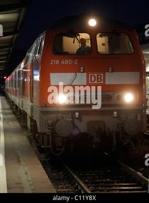218 series diesel locomotive from 1972 on a regional express train from the Deutsche Bahn AG, in Heilbronn railway - Stock Photo