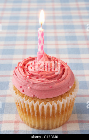 A cupcake with a candle - Stock Photo