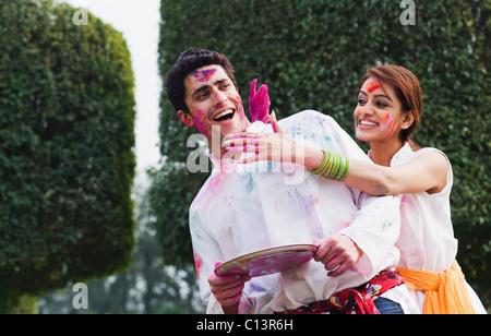Couple celebrating Holi - Stock Photo