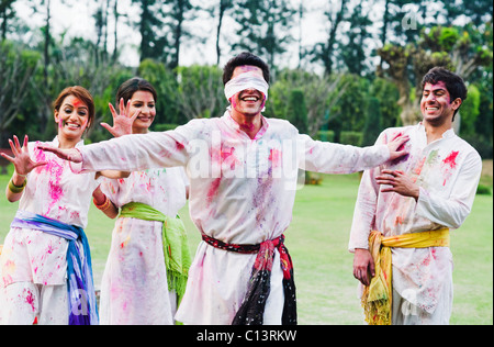 Friends celebrating Holi - Stock Photo