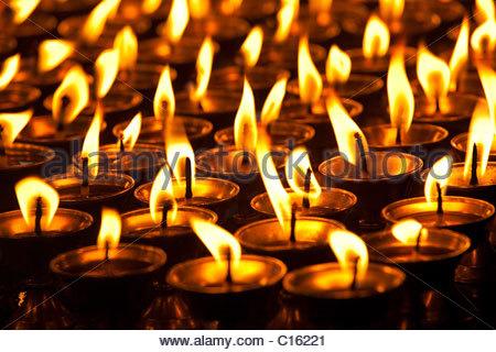 Candles burning in temple, McLeod Ganj,Himachal Pradesh, India - Stock Photo