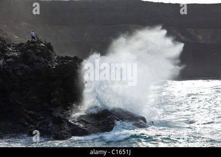 Heavy Atlantic seas breaking against rocks at the seaside village of Los Molinos on the Canary Island of Fuerteventura - Stock Photo