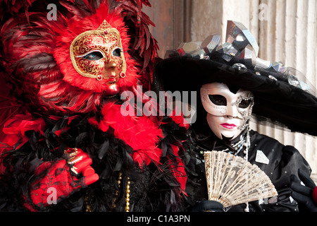 Two people in costume, the Venice Carnival, Venice, Italy - Stock Photo
