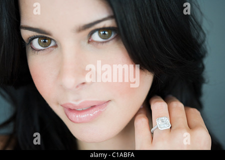 Young woman wearing engagement ring - Stock Photo