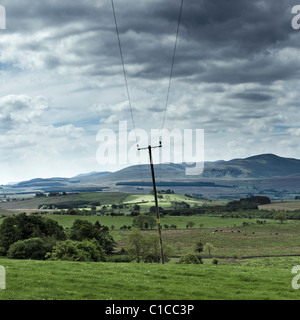Rural power lines in The Lake District, Cumbria, England UK - Stock Photo