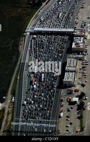 aerial view above heavy traffic at San Francisco Bay Bridge toll plaza Oakland California - Stock Photo