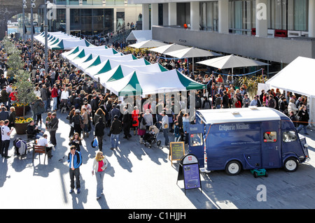 Royal Festival Hall forecourt being used for a weekend food market - Stock Photo