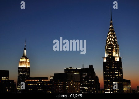 Chrysler Building and Empire State Building together at night - Stock Photo