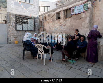 Morning gossip in the ancient city of Acre Israel - Stock Photo