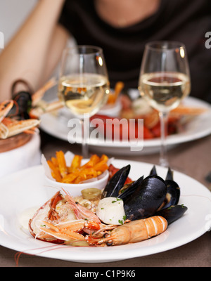 Prepared lobster, crayfish and mussel in plate - Stock Photo