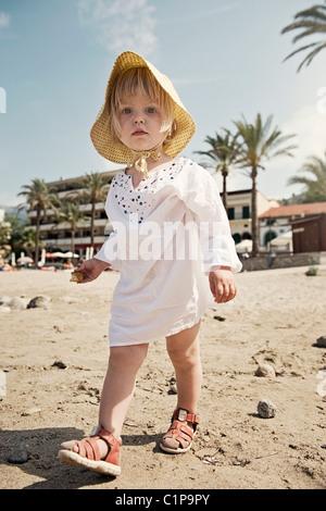 Girl walking on beach - Stock Photo