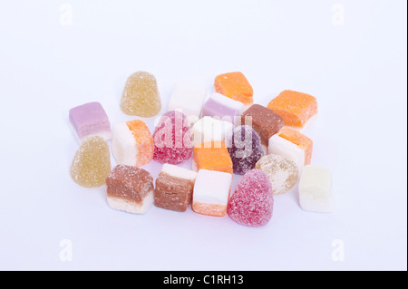 A selection of dolly mixtures traditional sweets on a white background - Stock Photo