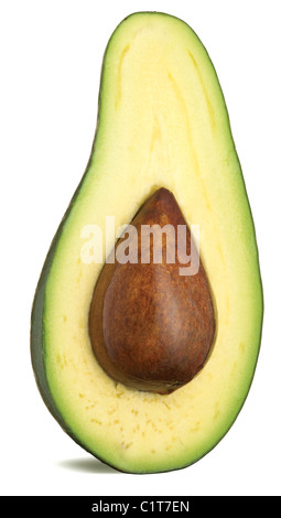 a half of an avocado with stone isolated on a white background with clipping path - Stock Photo