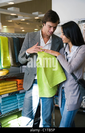 Couple shopping for bath towels - Stock Photo