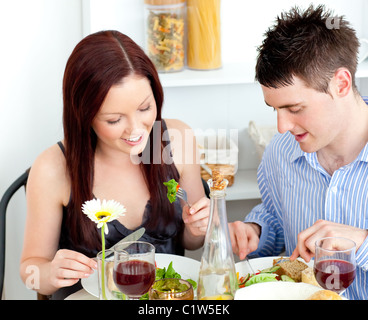 http://n450v.alamy.com/450v/c1w5ek/affectionate-couple-having-dinner-at-home-c1w5ek.jpg