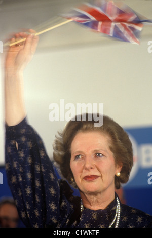 Mrs Margaret Thatcher 1983 election waving Union Jack flag with tears in her eyes. - Stock Photo