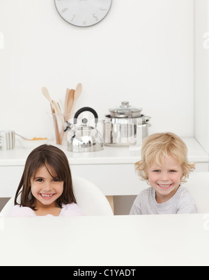Happy brother and sister waiting their breakfast - Stock Photo