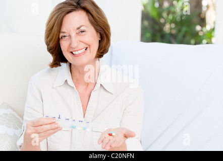Cute mature woman with pills - Stock Photo