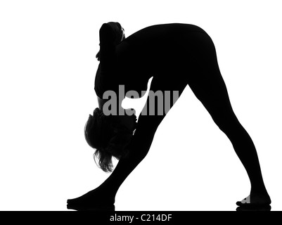parsvottanasana Intense Side Stretch Yoga pose woman posture position in silouhette on studio white background - Stock Photo