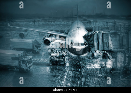 Boeing 757 commercial airliner at boarding gate at Hong Kong International Airport - Stock Photo