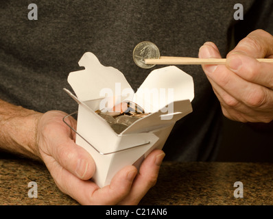 man holding Chinese food container containing US currency - Stockfoto