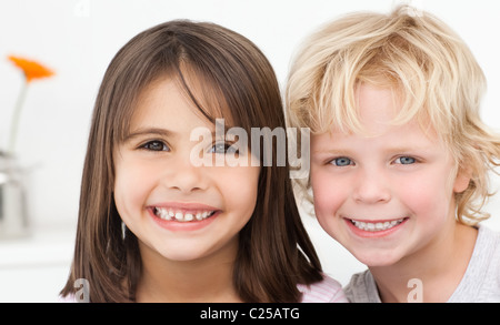 Adorable brother and sister posing in the kitchen - Stock Photo