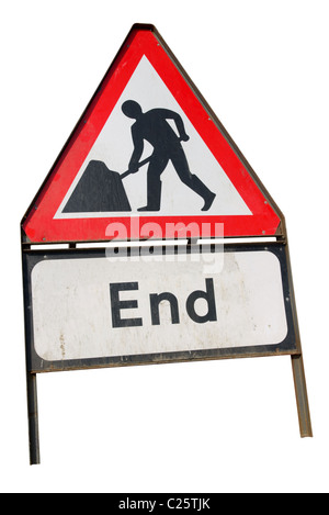 Dirty old British roadworks end sign isolated on a white background. - Stock Photo