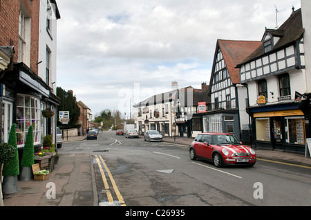 Main high street, A4104, with crooked old buildings at Upton upon Severn, Worcestershire, England, UK taken in Spring - Stock Photo
