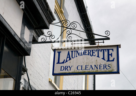 Old fashioned launderette sign taken in Upton upon Severn, Worcestershire, England, UK - Stockfoto