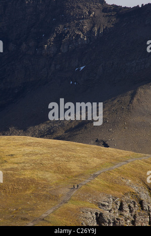 Alpine Landscape with Two Backpackers Walking on Mountain Trail - Stock Photo