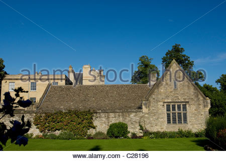 Stone building with Boston ivy and green lawn. - Stock Photo