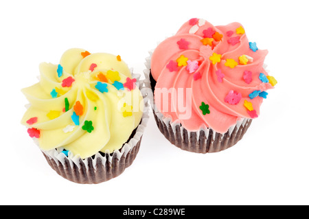 Yellow lemon and pink  berry iced chocolate cupcakes decorated with sprinkles on white background isolated. - Stock Photo