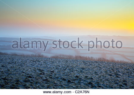 Winter sunrise over frost covered countryside, near Withypool, Exmoor National Park, Somerset, England, UK - Stock Photo
