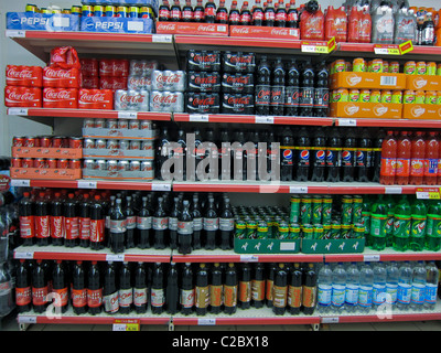 Detail, Shelves, Coca Cola Drinks in Bottles on Display in Supermarket, Paris, France - Stock Photo