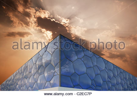 the Water Cube under the clouds - Stock Photo