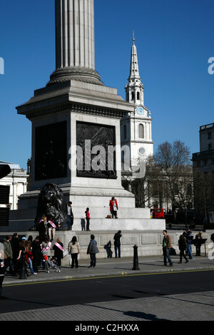 View past the base of Nelson's Column to St Martin-in-the-Fields church, Trafalgar Square, London, UK - Stock Photo