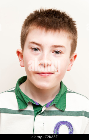 A MODEL RELEASED picture of an eleven year old boy indoors - Stock Photo
